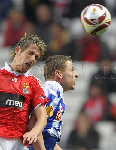 Berlin's Patrick Ebert (R) and Benfica's Fabio Coentrao (L) rise for a header during UEFA Europa League's round of 32 second leg Benfica Lisbon vs Hertha BSC Berlin in Lisbon, Portugal, 23 February 2010. Photo: SOEREN STACHE /Actionplus. Editorial UK Licenses Only