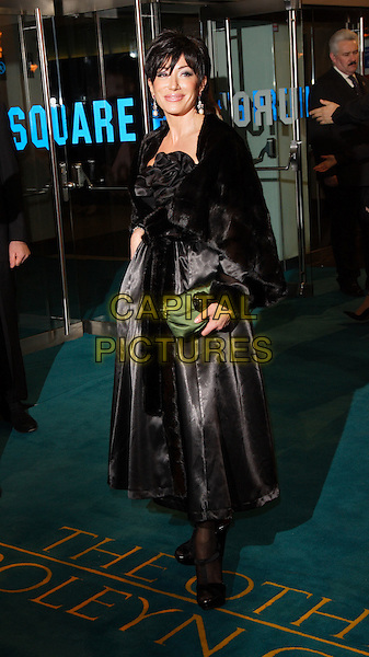 "NANCY DELL'OLIO.""The Other Boleyn Girl""  Royal Film Premiere, Odeon Cinema, Leicester Square, London, England,.19th February 2008.full length black dress green clutch bag fur coat corsage.CAP/ROS.?Steve Ross/Capital Pictures"