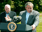 Camp David, MD - August 18, 2006 -- United States President George W. Bush holds a press availability after meeting with his economic advisors at Camp David, Maryland, Friday, August 18, 2006.  Vice President Dick Cheney looks on.<br /> Credit: Ron Sachs / Pool via CNP