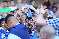Callum Paterson of Cardiff City holds a bottle of champagne on his head as Cardiff celebrate after being automatically promoted to the Premier League after the final whistle of the Sky Bet Championship match between Cardiff City and Reading at The Cardiff City Stadium, Wales, UK. Sunday 06 May 2018