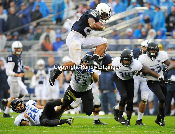 Penn State true freshman RB Saquon Barkley (26) hurdles Buffalo's Ryan Williamson (26) and Nick Gilbo (43) during a long gain. Barkley ran for 115 yards and a touchdown. The Penn State Nittany Lions defeated the Buffalo Bulls 27-14 at Beaver Stadium in State College, PA.