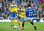 Rangers v St Johnstone...19.11.11   Scottish Premier League.Jody Morris is closed down by Matt McKay.Picture by Graeme Hart..Copyright Perthshire Picture Agency.Tel: 01738 623350  Mobile: 07990 594431