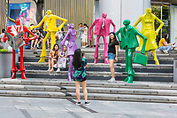 Shoppers Making Photos by Modern Fashion Sculptures outside ION Mall, Singapore, Orchard Road Street Scene.  Urban People by Kurt Lorenz Metzler.