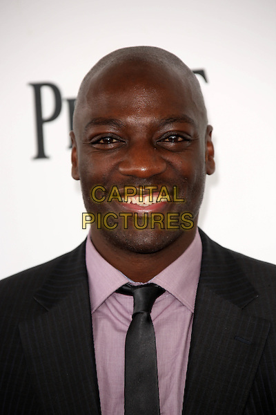 SANTA MONICA, CA - March 01: Adewale Akinnuoye-Agbaje at the 2014 Film Independent Spirit Awards Arrivals, Santa Monica Beach, Santa Monica,  March 01, 2014. Credit: Janice Ogata/MediaPunch<br /> CAP/MPI/JO<br /> &copy;JO/MPI/Capital Pictures