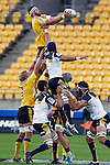 Hurricanes' lock Jeremy Thrush, centre, catches the ball in the line out agains the ACT Brumbies in the Super Rugby match at Westpac Stadium, Wellington, New Zealand, Friday, March 07, 2014. Credit: Dean Pemberton