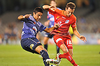 MELBOURNE, AUSTRALIA - JANUARY 23, 2010: Carlos Hernandez from Melbourne Victory fights for the ball with Fabian Barbiero from Adelaide United in round 24 of the A-league match between Melbourne Victory and Adelaide United FC at Etihad Stadium on January 23, 2010 in Melbourne, Australia. Photo Sydney Low www.syd-low.com