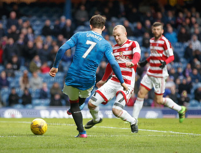 Joe Garner strokes the ball home to score his second of the match