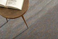 Tweed, a hand-cut tumbled mosaic, shown in Nero Marquina and Cavern, is part of the Tissé® collection for New Ravenna.