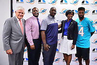 MIAMI, FL - SEPTEMBER 20: BankUnited Senior Executive Vice President Gerry Litrento, Miramar High School Athletic Director Alex Francois, Miramar High School Coach Pierre Senatus, BankUnited Vice President of Community Development & Outreach Katrina Wright and Miami Dolphins Wide Receiver (#14) Jarvis Landry surprise the Miramar Patriots varsity football team prior to the teamís practice as part of the 4 Downs for Finance financial literacy program sponsored by BankUnited. Landry share his thoughts on the importance of financial literacy at Miramar High School Media Center on September 20, 2016 in Miramar, Florida. Credit: MPI10 / MediaPunch