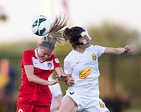 Kim Yokers (5) of the Western NY Flash goes up for a header with Ingrid Wells (9) of the Washington Spirit during the game at the Maryland SoccerPlex in Boyds, MD.  Washington tied Western NY, 1-1.