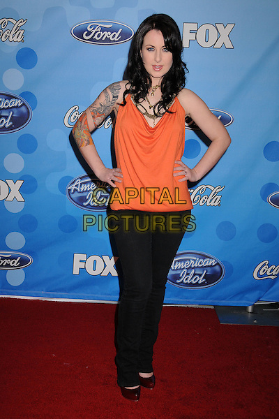 CARLY SMITHSON.American Idol Top 12 Party at Astra West/Pacific Design Center, West Hollywood, California, USA,.6 March 2008 .full length orange top hands on hips tattoos.CAP/ADM/BP.?Byron Purvis/Admedia/Capital PIctures