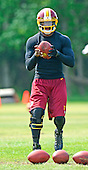 Washington Redskins quarterback Robert Griffin III (10) participates in passing drills on the side during the 2013 minicamp at Redskins Park in Ashburn, Virginia on Wednesday, June 12, 2013.<br /> Credit: Ron Sachs / CNP