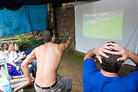 France fans gather in Pierrot Colonna's backyard to watch their World Cup match against Togo on June 23, 2006 in New York City.<br /> <br /> The World Cup, held every four years in different locales, is the world's pre-eminent sports tournament in the world's most popular sport, soccer (or football, as most of the world calls it).  Qualification for the World Cup is open to any country with a national team accredited by FIFA, world soccer's governing body. The first World Cup, organized by FIFA in response to the popularity of the first Olympic Games' soccer tournaments, was held in 1930 in Uruguay and was participated in by 13 nations.    <br /> <br /> As of 2010 there are 208 such teams.  The final field of the World Cup is narrowed down to 32 national teams in the three years preceding the tournament, with each region of the world allotted a specific number of spots.  <br /> <br /> The World Cup is the most widely regularly watched event in the world, with soccer teams being a source of national pride.  In most nations, the whole country is at a standstill when their team is playing in the tournament, everyone's eyes glued to their televisions or their ears to the radio, to see if their team will prevail.  While the United States in general is a conspicuous exception to the grip of World Cup fever there is one city that is a rather large exception to that rule.  In New York City, the most diverse city in a nation of immigrants, the melting pot that is America is on full display as fans of all nations gather in all possible venues to watch their teams and celebrate where they have come from.