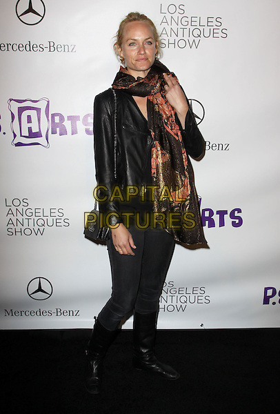 AMBER VALLETTA.Opening Night Preview Party of the LA Antique Show Benefiting P.S ARTS held At The Barker Hanger, Santa Monica, California, USA..April 21st, 2010.full length brown orange gold black print scarf leather jacket jeans denim knee high boots tucked in jeggings chanel bag purse .CAP/ADM/KB.©Kevan Brooks/AdMedia/Capital Pictures.