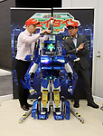 "November 21, 2017, Tokyo, Japan - Japanese robot creators Wataru Yoshizaki (R) of Asratec and Kenji Ishida (L) of Brave Robotics display the transformable robot ""J-deite Quarter"" which can change its shape of a robot to a vehicle at the ""Softbank Robot World 2017"" in Tokyo on Tuesday, November 21, 2017. Softbank's subsidiary Asratec and Brave Robotics have plan to launch a 4m tall transformable human ride robot ""J-deite RIDE"".     (Photo by Yoshio Tsunoda/AFLO) LWX -ytd-"