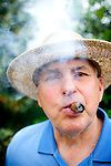 David Czarnecki, of Mechanicsburg, Pennsylvania, enjoys a cigar outside of the Augusta National Golf Club on the first tournament day of The Masters Golf Tournament in Augusta, Georgia April 8, 2010.