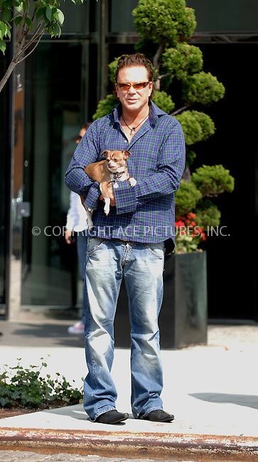 WWW.ACEPIXS.COM . . . . .  ....NEW YORK, MAY 17, 2006....Mickey Rourke seen with his dog in New York City.....Please byline: BRETT KAFFEE-ACEPIXS.COM.... *** ***..Ace Pictures, Inc:  ..(212) 243-8787 or (646) 769 0430..e-mail: picturedesk@acepixs.com..web: http://www.acepixs.com
