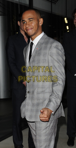 Lewis Hamilton .attending the McLaren Automotive Showroom Launch at One Hyde Park, Knightsbridge, London, England, UK, June 21st 2011..half length  grey gray plaid checked check suit black winking eye funny  tie suit white shirt .CAP/CAN.©Can Nguyen/Capital Pictures.