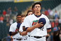 Fort Myers Miracle relief pitcher Trevor Hildenberger (12) during the national anthem before a game against the Brevard County Manatees on April 13, 2016 at Hammond Stadium in Fort Myers, Florida.  Fort Myers defeated Brevard County 3-0.  (Mike Janes/Four Seam Images)