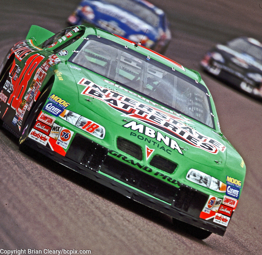 Bobby Labonte leads Robert Pressley and Dale Earnhardt through turn 2 at Phoenix in November 2000. (Photo by Brian Cleary/www.bcpix.com)