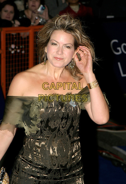 PENNY SMITH.National Television Awards 2005 at the Royal Albert Hall, SW7, London, UK..October 25th, 2005.Ref: AH.half length off the shoulder touching ear green.www.capitalpictures.com.sales@capitalpictures.com.© Capital Pictures.