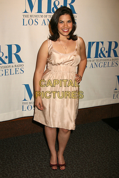 "AMERICA FERRERA .MT & R's 24th Annual William S. Paley Television Festival, ""Ugly Betty"" at the Directors Guild, West Hollywood, California, USA..March 12th, 2007.full length fererra pink satin dress hand on hip.CAP/ADM/BP.©Byron Purvis/AdMedia/Capital Pictures"
