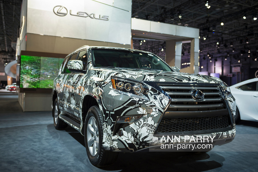 """Manhattan, New York, USA. April 12, 2017.  2017 Lexus SUV with exterior, covered in pattern by fashion designer Zang Toi is on display at the New York International Auto Show, NYIAS, during the first Press Day at the Javits Center. About two Press Conferences were held each hour at the annual event """"Where the auto industry gathers to unveil the future."""""""