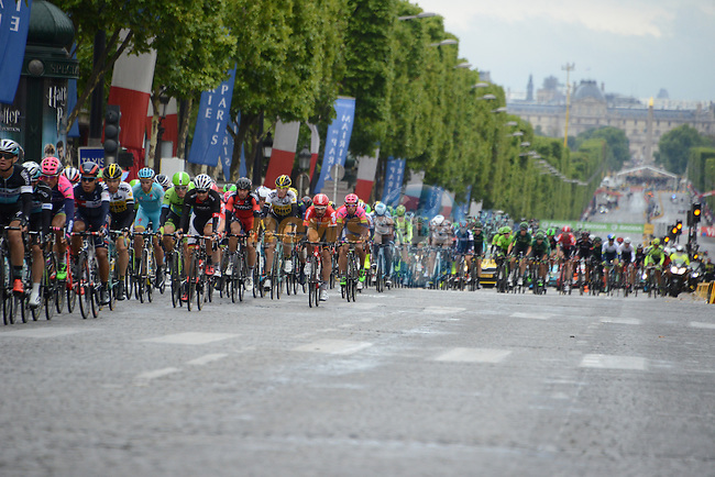 The peloton on the Champs Elysees in Paris during Stage 21 of the 2015 Tour de France running 109.5km from Sevres to Paris - Champs Elysees, France. 26th July 2015.<br /> Photo: ASO/B.Bade/Newsfile