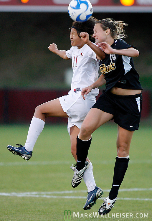FSU's Mami Yamaguchi, left, and Sara Clapham battle for the ball in the first half of NCAA soccer action against the Kennesaw State Owls in Tallahassee November 16, 2007.(Mark Wallheiser/TallahasseeStock.com)