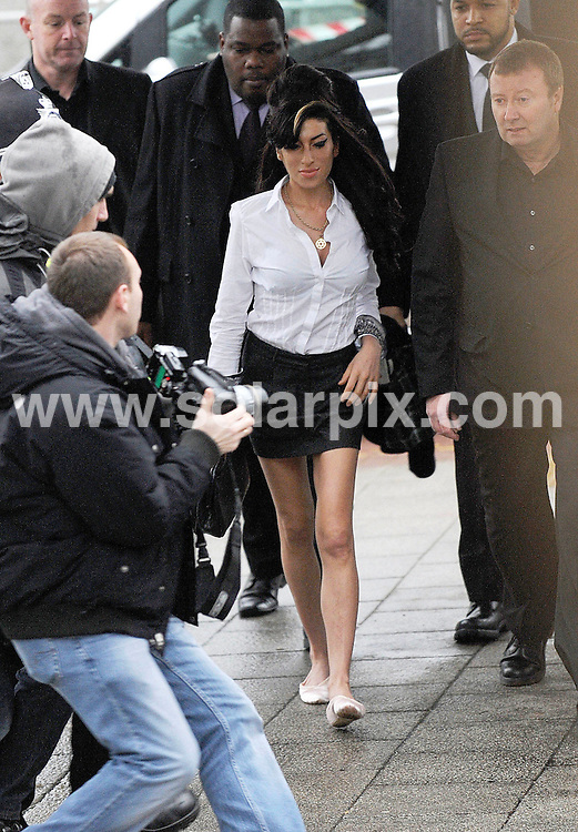 **ALL ROUND PICTURES FROM SOLARPIX.COM**.**WORLDWIDE SYNDICATION RIGHTS**.Singer Amy Winehouse pleaded guilty today on acharge of assault of a theatre manager at Milton Keynes Crown Court . she was fined £100.00 and given a conditional discharge...This pic:Amy Winehouse..JOB REF: 10511       SKD       DATE:20.01.2010.**MUST CREDIT SOLARPIX.COM OR DOUBLE FEE WILL BE CHARGED**.**MUST NOTIFY SOLARPIX OF ONLINE USAGE**.**CALL US ON: +34 952 811 768 or LOW RATE FROM UK 0844 617 7637**