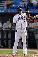 New York Mets Jose Reyes #7 reacts to a call by the umpire during an exhibition game vs the Michigan Wolverines at Digital Domain Ballpark in Port St. Lucie, Florida;  February 27, 2011.  New York defeated Michigan 7-1.  Photo By Mike Janes/Four Seam Images