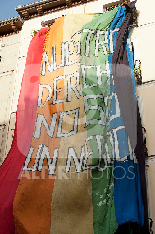 "Inauguration of the gay pride festivities held MADO2012 in the Madrid district of Chueca.Some gay and lesbian members of Spain hung on the balcony of a house in the neighborhood of Chueca a banner with the slogan ""Our rights are not a business"".(Alterphotos/Ricky)"