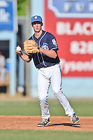 Asheville Tourists third baseman Ryan McMahon #5 fields and throws to first during a game against the Lakewood BlueClaws at McCormick Field on May 3, 2014 in Asheville, North Carolina. The BlueClaws defeated the Tourists 7-4. (Tony Farlow/Four Seam Images)