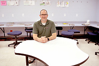 RACHEL DICKERSON/MCDONALD COUNTY PRESS Bill Chamberlain, a social studies teacher at Noel Junior High, is pictured at an interactive table with a white board surface he recently purchased with a grant from the McDonald County Schools Foundation.