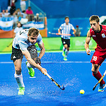 Lucas Rossi #27 of Argentina passes the ball during Argentina vs Belgium  in the men's gold medal game at the Rio 2016 Olympics at the Olympic Hockey Centre in Rio de Janeiro, Brazil.