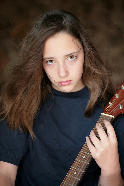 Stock Photo of a Rock and Roll Teen Girl With Her  Guitar
