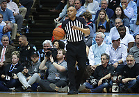 CHAPEL HILL, NC - FEBRUARY 25: Official Bill Covington holds the ball during a game between NC State and North Carolina at Dean E. Smith Center on February 25, 2020 in Chapel Hill, North Carolina.