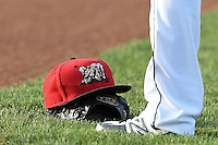 Batavia Muckdogs hat and a TPX Pro glove on the field a game against the Jamestown Jammers on July 25, 2014 at Dwyer Stadium in Batavia, New York.  Batavia defeated Jamestown 7-2.  (Mike Janes/Four Seam Images)