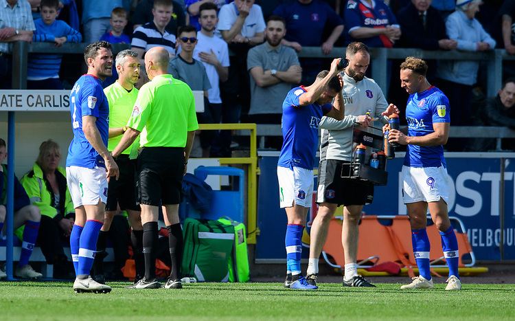 Referee Lee Mason, right, speaks to fourth official Seb Stockbridge<br /> <br /> Photographer Chris Vaughan/CameraSport<br /> <br /> The EFL Sky Bet League Two - Carlisle United v Lincoln City - Friday 19th April 2019 - Brunton Park - Carlisle<br /> <br /> World Copyright © 2019 CameraSport. All rights reserved. 43 Linden Ave. Countesthorpe. Leicester. England. LE8 5PG - Tel: +44 (0) 116 277 4147 - admin@camerasport.com - www.camerasport.com