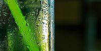 Abstracts of a glass with a straw and bubbles,