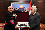 Palestinian President Mahmoud Abbas meets with the Apostolic Nuncio in Jerusalem, at his headquarter, in the West Bank city of Ramallah, on August 16, 2017. Photo by Thaer Ganaim