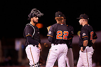 San Jose Giants catcher Joey Bart (9) talks to relief pitcher Camilo Doval (22) and first baseman Ryan Kirby (10) during a California League game against the Visalia Rawhide on April 12, 2019 at San Jose Municipal Stadium in San Jose, California. Visalia defeated San Jose 6-2. (Zachary Lucy/Four Seam Images)