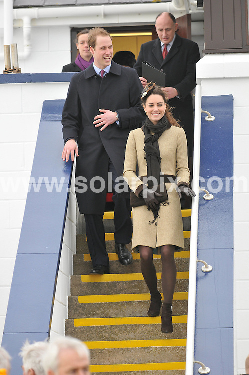 **ALL ROUND PICTURES FROM SOLARPIX.COM**                                             **WORLDWIDE SYNDICATION RIGHTS**                                                                                  Caption: HRH Prince William and his bride-to-be Kate Middleton at the RNLI Lifeboat - naming ceremony at Trearddur Bay Lifeboat Station, Holyhead, Isle of Anglesey, off the coast of North Wales, UK. 24 February 2011.                                                                              This pic: Prince William, Kate Middleton                                                                                             JOB REF: 12891 MSR       DATE: 24_02_2011                                                           **MUST CREDIT SOLARPIX.COM OR DOUBLE FEE WILL BE CHARGED**                                                                      **MUST AGREE FEE BEFORE ONLINE USAGE**                               **CALL US ON: +34 952 811 768 or LOW RATE FROM UK 0844 617 7637**