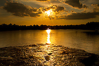 Sunset on the Arkansas River after a rain storm at Wilson Rock, near Muldrow Oklahoma.