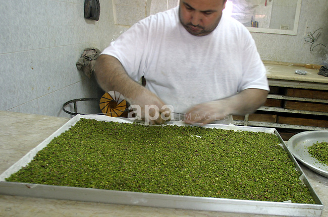 A Palestinian sweets maker prepares the dough of  Baqlawa at his factory in the old city of Jerusalem on July4, 2009. Photo by Mahfuz Abu Turk