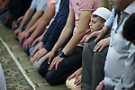 """A picture taken on May 16, 2018 shows Palestinian Muslim worshipers perform """"Taraweeh"""", nightly prayer of the holy month of Ramadan, at a mosque, in the West Bank city of Nablus. Ramadan is sacred to Muslims because it is during that month that tradition says the Koran was revealed to the Prophet Mohammed. The fast is one of the five main religious obligations under Islam. Muslims around the world will mark the month, during which believers abstain from eating, drinking, smoking and having sex from dawn until sunset. Photo by Ayman Ameen"""