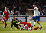 Lee McCulloch tries to take the ball around the keeper