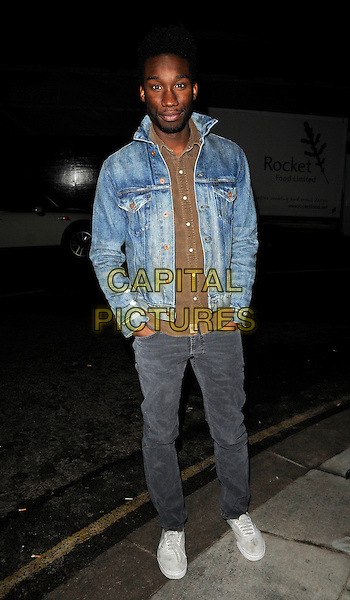 "NATHAN STEWART-JARRETT.The ""Art Stars"" launch party, Phillips de Pury & Co., Howick Place, London, England..December 6th, 2010.full length jeans denim jacket brown shirt hands in pockets .CAP/CAN.©Can Nguyen/Capital Pictures."