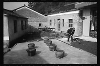 A villager dries camellia oil tea seeds in the sun in Xialu Village in Poyang county at Poyang Lake, Jiangxi Province, November 2017. Poyang Lake, located in the north of Jiangxi Province, is the largest freshwater lake in China. It fluctuates dramatically between wet and dry seasons, from 3,500 square kilometres down to about 200 square kilometres. The lake provides a habitat for half a million migratory birds.