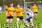 Listowel V Annascaul : Annascaul's Cathal Ferriter wins the ball ahead of Listowel Emmets Tom Melvin in their Castleisland Junior Premier Club Championship game in Frank Sheehy Park, Listowel on Saturday evening last.